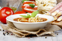 Italian cuisine: tomato soup, breadsticks Stock Photography