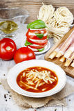 Italian cuisine: tomato soup, breadsticks Royalty Free Stock Photography