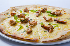 Italian delicious pizza with chicken, cheese and ham. Royalty Free Stock Image