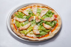 Italian delicious pizza with lettuce, cheese and ham. Stock Images