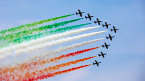 The Italian demonstration team Frecce Tricolori. UDINE, ITALY - 01 MAY 2009: The Italian demonstration team Frecce Tricolori performes at the Airshow on May 01 Royalty Free Stock Photos