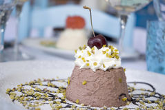 Italian dessert. Dessert served with a cherry on the top royalty free stock photo