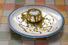 Italian Dessert cream panna cotta. Italian Dessert called panna Cotta : cream, pistachio and chocolate decorative stock photos