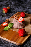 Italian dessert. Chocolate panna cotta with mint and strawberry. Dark wood background. close up, vertical stock photos