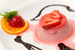 Italian dessert panna cotta with strawberry. Stock Photo