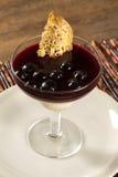 Italian dessert pannacotta with redfruit. Stock Photography
