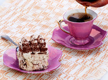 Italian dessert, Tiramisu, I poured a cup of coffe Royalty Free Stock Photos