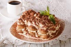 Italian dessert tiramisu on a plate and espresso coffee close-up Stock Photos