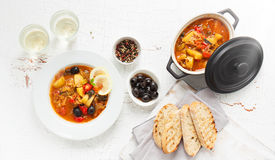Italian dinner with italian soup minestrone, olives, bread, pepper and white wine Royalty Free Stock Images
