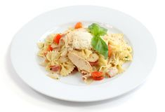 Italian dish. Farfalle with chicken, bacon and cheese on white background Stock Photo