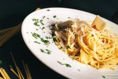 Italian dish with close up of spaghetti carbonara and parmesan. Delicious Italian dish with close up of spaghetti carbonara and parmesan Stock Images