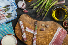 Italian dish, fresh asparagus wrapped in pancetta and grilled Royalty Free Stock Image