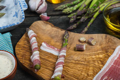 Italian dish, fresh asparagus wrapped in pancetta and grilled Stock Image
