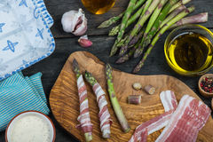 Italian dish, fresh asparagus wrapped in pancetta and grilled Royalty Free Stock Photo