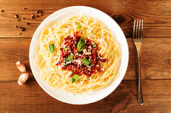 Italian dish - pasta with sundried tomato and basil. Top view.  Royalty Free Stock Image