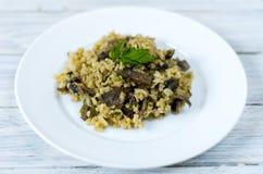 Italian dish Risotto. Garnish dish with mushrooms. Stock Photos