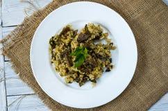 Italian dish Risotto. Garnish dish with mushrooms. Top view. Royalty Free Stock Image