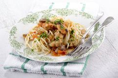 Italian dish with spaghetti and mussels Stock Images