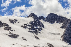 Italian Dolomites covered with snow in summer Royalty Free Stock Photos