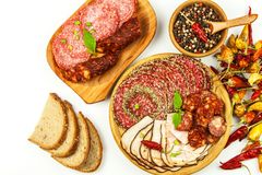Italian dried salami crusted in ground black pepper. Bacon and sausage for food. Traditional unhealthy food.  royalty free stock images