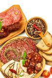 Italian dried salami crusted in ground black pepper. Bacon and sausage for food. Traditional unhealthy food.  royalty free stock photography