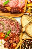 Italian dried salami crusted in ground black pepper. Bacon and sausage for food. Traditional unhealthy food.  stock photos