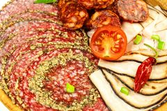 Italian dried salami crusted in ground black pepper. Bacon and sausage for food. Traditional unhealthy food.  royalty free stock photos