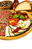 Italian dried salami crusted in ground black pepper. Bacon and sausage for food. Traditional unhealthy food.  stock image
