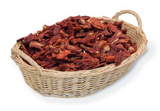 Italian dried tomatoes. Basket of italian tomatoes dried at the sun Stock Photos