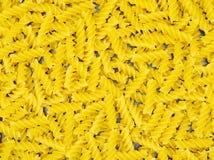 Dried yellow pasta. Italian dried yellow pasta - torti - isolated Royalty Free Stock Photo