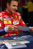 Italian driver Davide Rigon signing autographs Royalty Free Stock Image