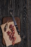 Italian dry sausage, knife and cutting board.Top view Stock Photography