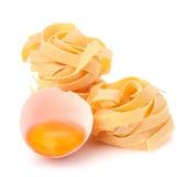 Italian egg pasta fettuccine nest Royalty Free Stock Photos