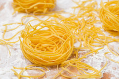 Italian egg pasta nests on a floured cutting board Stock Image