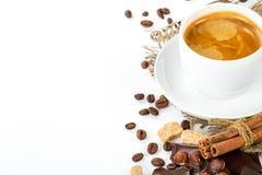Italian espresso with cinnamon coffee beans brown sugar Royalty Free Stock Image