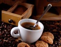 Italian espresso coffee and amaretti Stock Photos