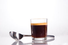 An italian espresso in a little glass royalty free stock photography