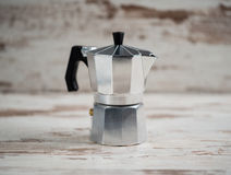 Italian espresso machine over wooden background Royalty Free Stock Image