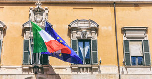 Italian and EU flags on a building - Rome, Italy Stock Images