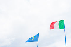 Italian and european community flag on cloudy sky Stock Images