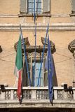 Italian and European Flag hanging from antique building in Rome, Italy, Europe Stock Image
