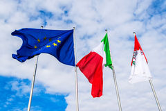 Italian and European flag waving in the wind.  Royalty Free Stock Photography