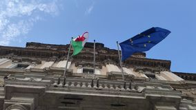 Italian and european flags vawing together on government palace. Italian and european flags vawing together in the wind on the facade of government palace stock footage