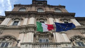 Italian and european flags vawing together on government palace. Italian and european flags vawing together in the wind on the facade of government palace stock video footage