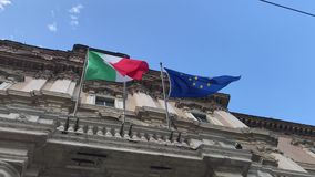Italian and european flags vawing together on government palace. Italian and european flags vawing together in the wind on the facade of government palace stock video