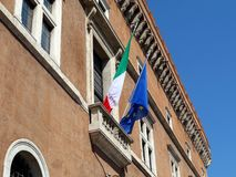 Italian and European Union Flags. The Italian and European Flags flying on the balcony of a classical Rome public building, iItaly stock photo