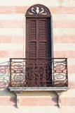 Italian facade with balcony. Pictoresque italian facade with balcony near garda lake Royalty Free Stock Images