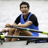Italian face. Bosbaan, Amsterdam, Netherlands - 23 July 2011: Italy's Lightweight Double Sculls Bowman, Leonardo Boccuni, sticks out his tongue after finishing Royalty Free Stock Photo
