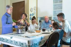 An Italian family has lunch with pasta royalty free stock photos