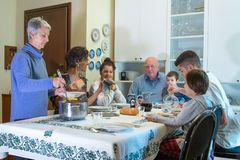 An Italian family has lunch with pasta stock images